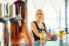 Cocktail in woman hand on the open terrace in bar during summer time royalty free stock photos