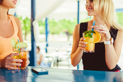 Cocktail in woman hand on the open terrace in bar during summer time stock photo