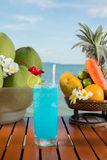 Cocktail. Wonderful sea view concept with blue color cocktail drinks, coconuts, papaya, pineapple and accessories at Sokha Beach resort, Sihanouk Ville, Cambodia Royalty Free Stock Photography
