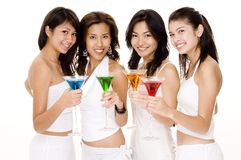Cocktails #1. Four young women in white with colorful cocktails Royalty Free Stock Photography