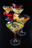 Cocktails. Different cocktails or longdrinks garnished with fruits stock photos