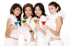 Cocktails #2. Four attractive asian women in white with colorful cocktails Royalty Free Stock Photos