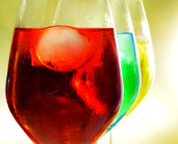 Cocktails. Some glasses with cocktails of different colors Royalty Free Stock Images