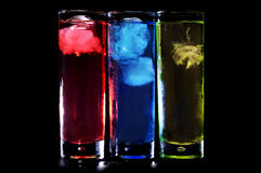 Cocktails. Some glasses with cocktails of different colors on a black background Royalty Free Stock Images