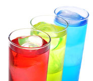 Cocktails. Some glasses with cocktails of different colors on a white background Royalty Free Stock Images