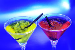 Cocktails. Cocktail glasses with different coctkails on a blue background royalty free stock photography