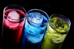 Cocktails. Some glasses with cocktails of different colors on a black background Royalty Free Stock Image