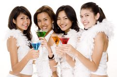 Cocktails #3. Four pretty young asian women in white with colorful drinks Royalty Free Stock Images