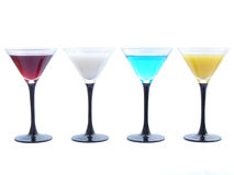 Cocktails. Assorted drinks in martini glasses royalty free stock photos