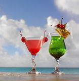 Cocktails. Two red and green cocktails on the beach Stock Photography