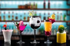 Cocktails alcohol bar selection trendy hotel bartender garnish. Selection of fine non alcoholic garnished cocktail drinks beverage bar club mixologist beer stock photo