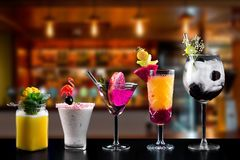 Cocktails alcohol bar selection trendy hotel bartender garnish. Selection of fine non alcoholic garnished cocktail drinks beverage bar club mixologist beer stock photos