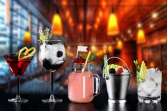 Cocktails alcohol bar selection trendy hotel bartender garnish royalty free stock photos