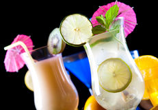 Cocktails, alcohol drinks with fruits Stock Images