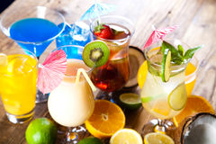 Cocktails, alcohol drinks with fruits Stock Image