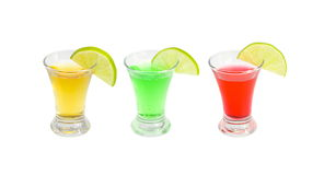 Cocktails alcoholic with a lime. On the white isolated background royalty free stock photography
