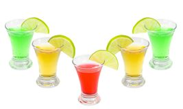 Cocktails alcoholic with a lime. On the white isolated background royalty free stock image