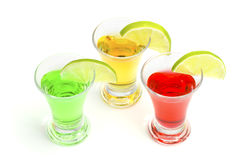 Cocktails alcoholic with a lime. On the white isolated background Stock Photos