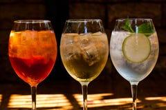 Cocktails: aperol spritz, sprizz (spriss), Martini royale. (dark background). Sparkling wine. Champagne. Classic cocktails in wine glasses with sparkling wine stock image