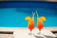 Cocktails on the background of the pool. royalty free stock image