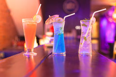 Cocktails on the bar counter in night club Royalty Free Stock Image