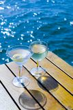 Cocktails on the Bay. A Glass of Wine, a Martini, the Sun and Brilliant Blue Water.  Ahhh Stock Image