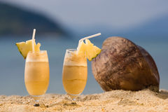 Cocktails on the beach. Two yellows cocktails stands on the beach Royalty Free Stock Photo