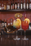 Cocktails with bottles. Two cocktails with bottles background in a bar Stock Photography