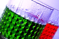 Cocktails. Closeup of some glasses with beverages of different colors in a club Stock Photos