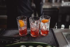 Cocktails in a cocktail bar with orange and red stock image