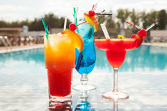 Cocktails. Cold cocktails on the background of the pool Stock Image