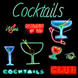 Cocktails Collage Neon Sign. Collage of alcoholic beverages related neon sign isolated on black background stock photos