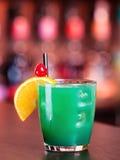 Cocktails collection - Blue Whale. Ingredients: 1 part vodka 1 part Blue Curacao liqueur 1 part orange juice 1 part pineapple juice 1 part sweet and sour mix royalty free stock image