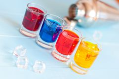 Cocktails - Color soft drinks with ice on light Royalty Free Stock Images