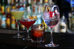 Cocktails on different drinking glasses. On a bar Stock Photo