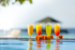 Cocktails drinks placed next to swimming pool Royalty Free Stock Photography