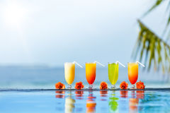 Cocktails drinks placed next to swimming pool Royalty Free Stock Image