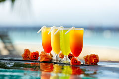 Cocktails drinks placed next to swimming pool Stock Photo