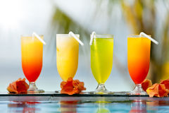 Cocktails drinks placed next to swimming pool Royalty Free Stock Photo