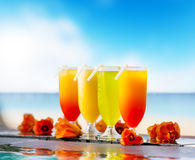 Cocktails drinks placed next to swimming pool Royalty Free Stock Images