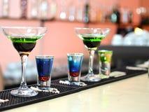 Cocktails en schoten Stock Foto's