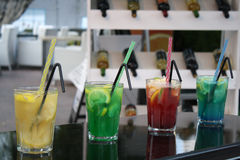 Drinks. Four different color drinks on a restaurant background Stock Photography