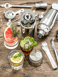 Cocktails with fruits and ice. Bar drink tools Royalty Free Stock Photography
