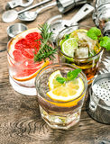 Cocktails with fruits ice. Cold drinks with mint Royalty Free Stock Photography