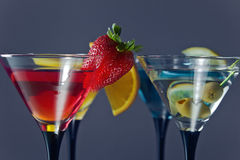 Cocktails garnished with fruits stock image