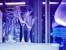 Cocktails Glass Bar rack Night club Party event. Blue tone Background Royalty Free Stock Photography