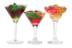 Cocktails glass ten. Glass jars with colorful cocktails on a white background stock photos