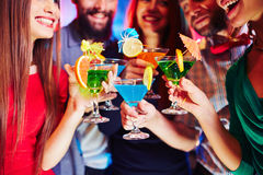Cocktails in hands Stock Image