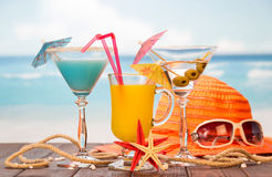 Cocktails, hat and sunglasses Stock Photo