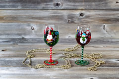Cocktails for the Holiday Season. Horizontal image of holiday drinking glasses, filled with drink, on rustic wood royalty free stock photo